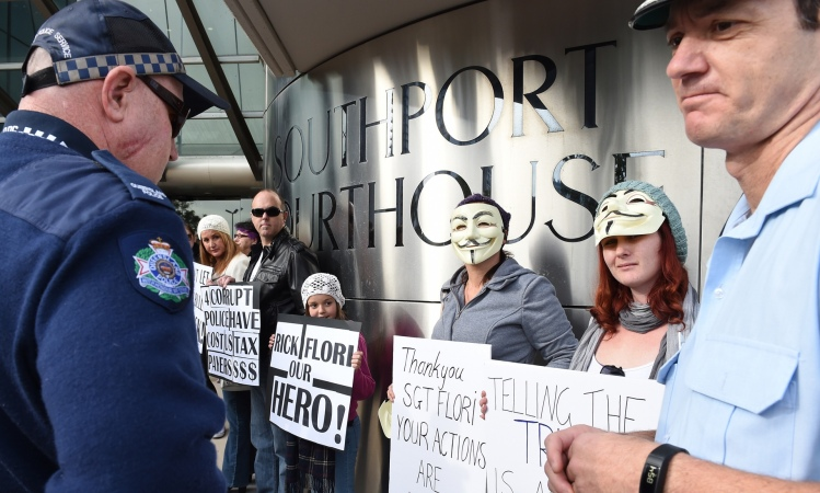 Supporters of policeman Rick Flori outside the Southport magistrates court on the Gold Coast, Wednesday, 15 July, 2015. Photograph: Dave Hunt/AAP
